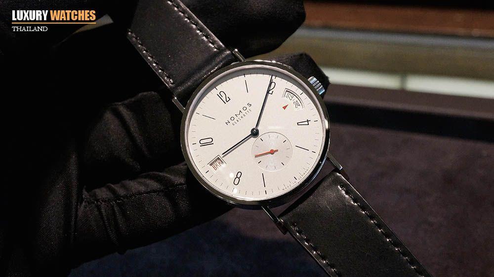 """NOMOS Glashütte เป็นแบรนด์นาฬิกาสัญชาติเยอรมันที่คนไทยจะเริ่มคุ้นหูหรือรู้จักกันบ้างไม่มากก็น้อย ด้วยการออกแบบที่เรียบง่ายตามสไตล์ """"เบาเฮาส์"""" (Bauhaus Design) และกลไก in-house ที่เทียบชั้นกับแบรนด์คู่แข่งที่ราคาในตำแหน่งเดียวกันได้อย่างภูมิใจ และ LWT เชื่อว่าหลายคนที่ตามหา dress watch ที่ """"ลงตัว"""" นั้นจะมีชื่อของ NOMOS Glashütte ไว้เป็นทางเลือกหนึ่งในการตัดสินใจ ดังนั้น LWT จึงเลือกนาฬิการุ่น NOMOS Tangomat GMT Limited Edition for Bangkok ที่จัดผลิตขึ้นเพียงแค่ 30…"""