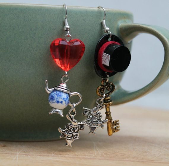 Curiouser  Mismatched Earrings by WensanteSparkles on Etsy