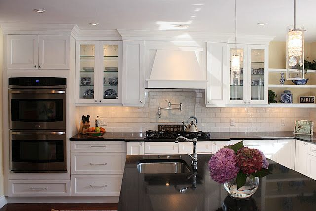Love the shaker style white cabinets, black granite, island ...