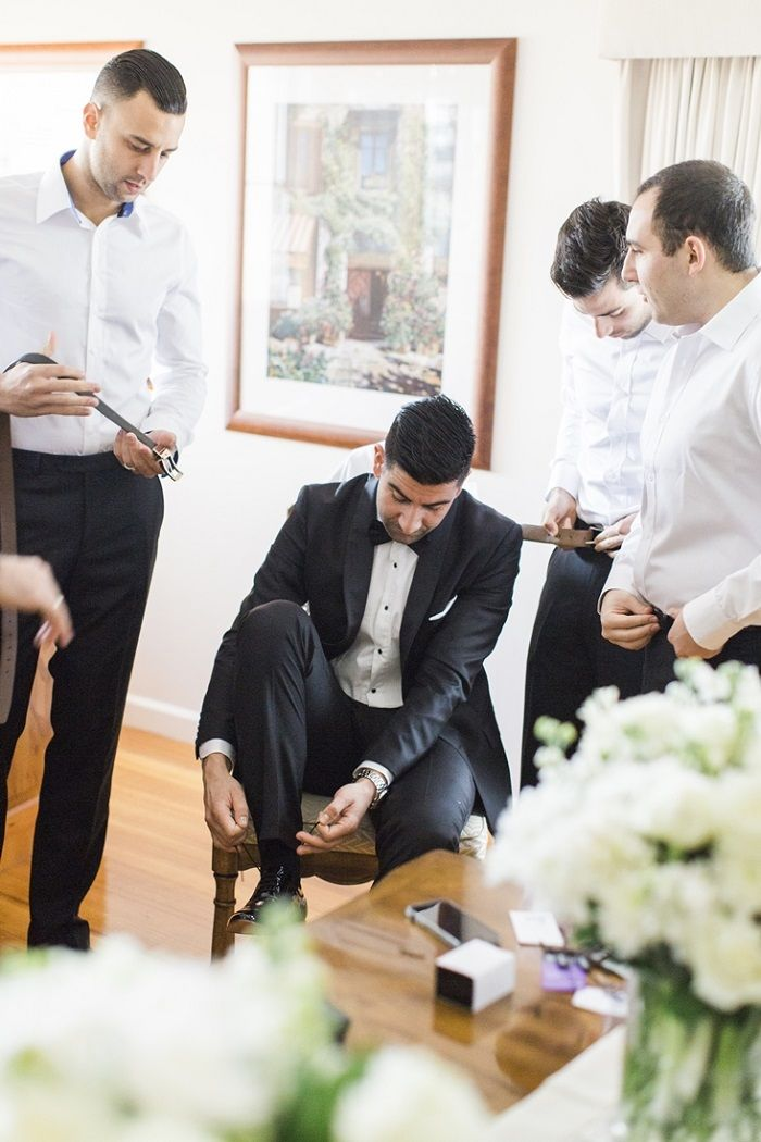 Groom & groomsmen're getting ready for A Big Fat Greek Winter Wedding | I take you