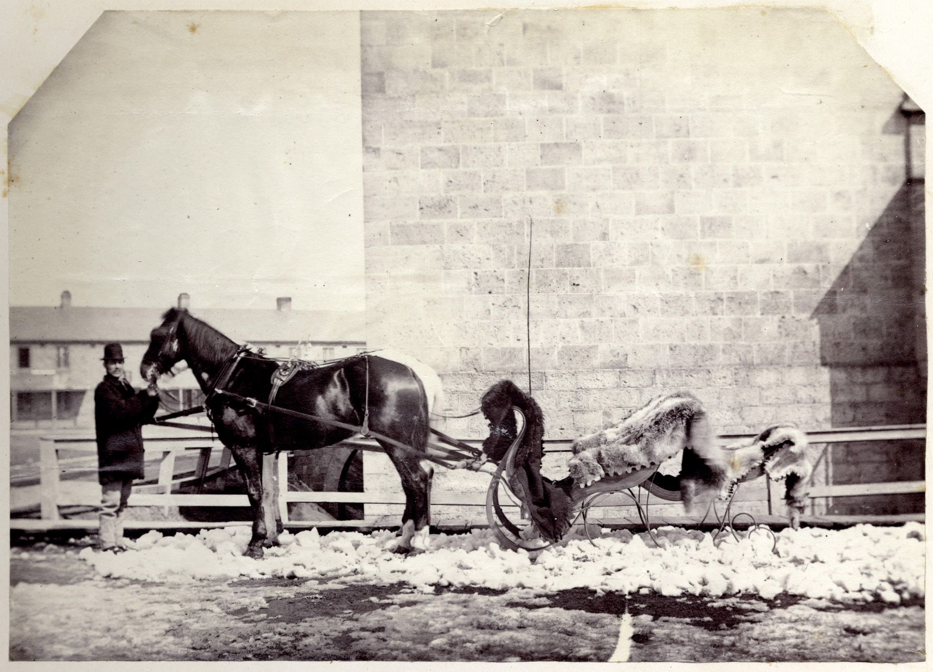Outside the New Fort on the Exhibition grounds in 1867. The sleigh is draped in furs.