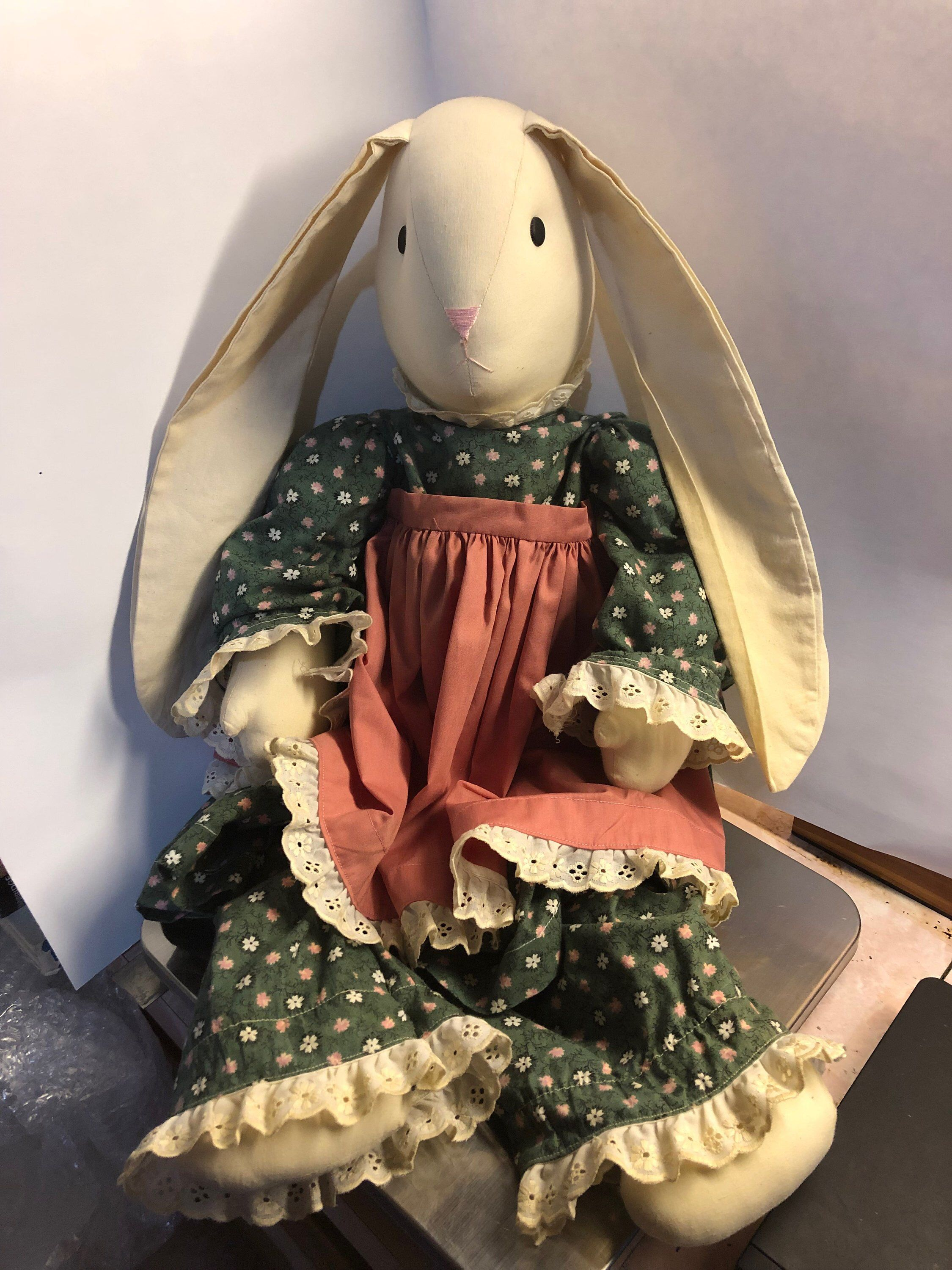 Vintage Country Primitive Bunny Rabbit Cloth Doll with Dress is part of Vintage Country Clothes - Used  Is a 26 inch doll  Measures 26 x 14 x 6 inches  The bunny is wearing a prairie dress  Overall good condition