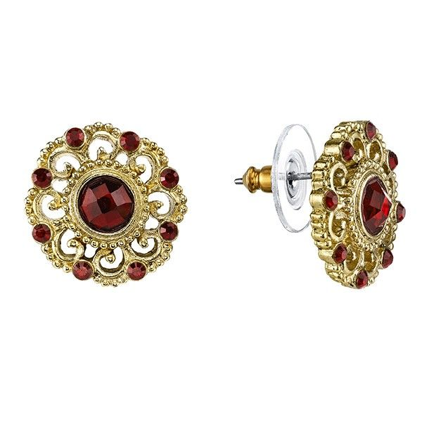 Featuring a set of gold-toned filigree stud earrings decorated with large red center stones. Small red crystals dot the outer edges of the earrings to add a touch of sparkle.