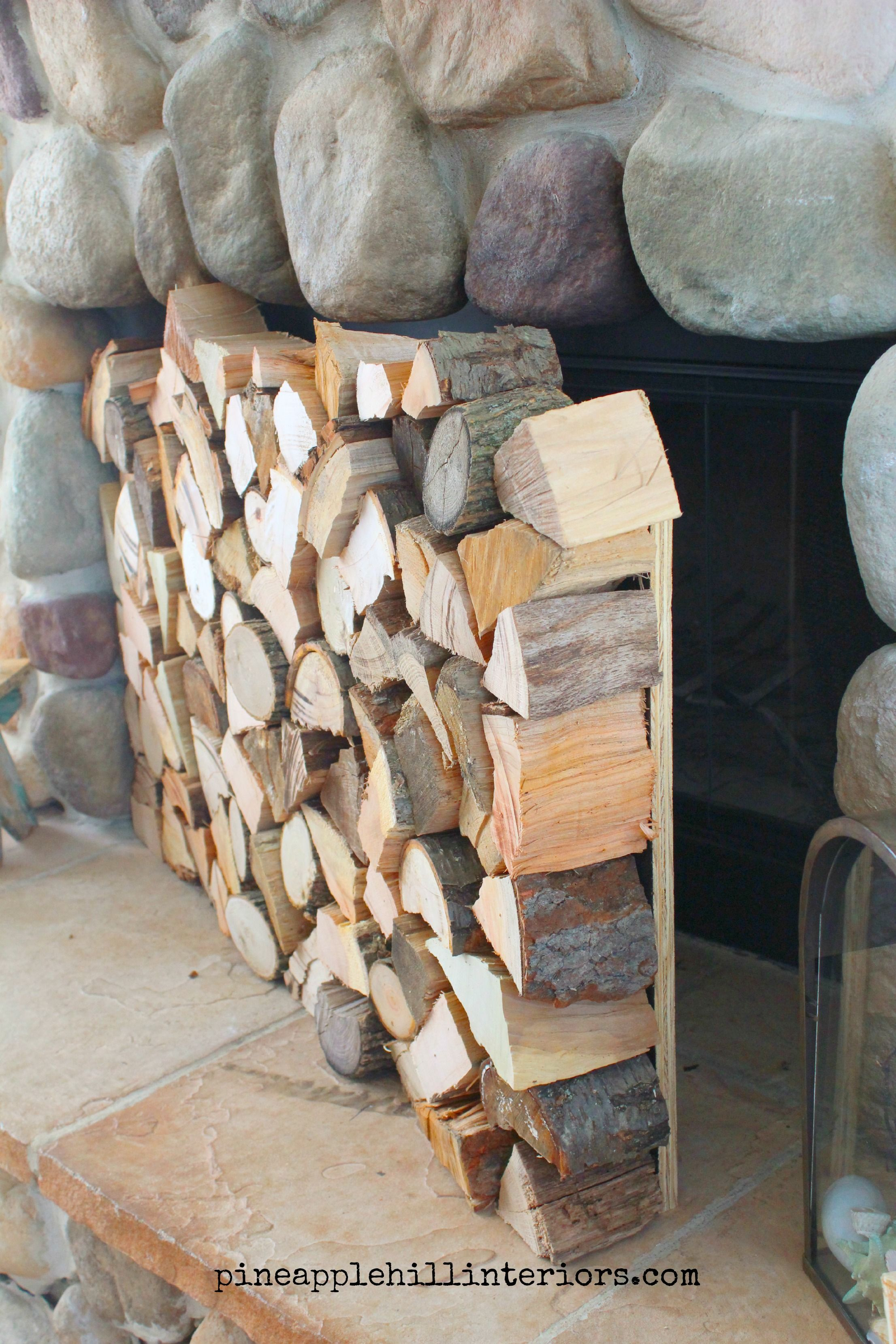 faux stacked logs fireplace facade