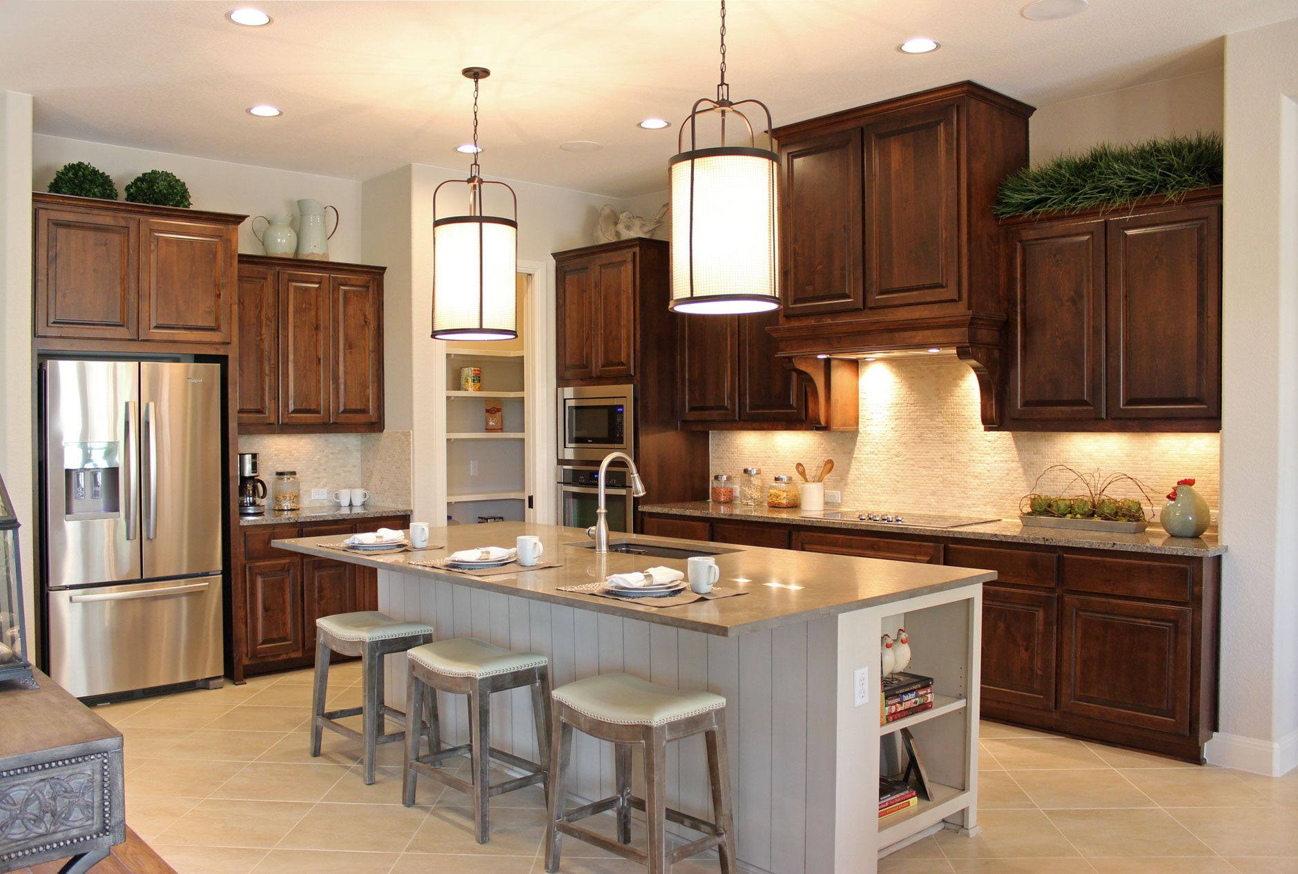 Burrows Cabinets kitchen cabinets in stained knotty alder and