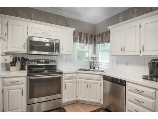 Nice paint color with the stainless appliances and white cabinets