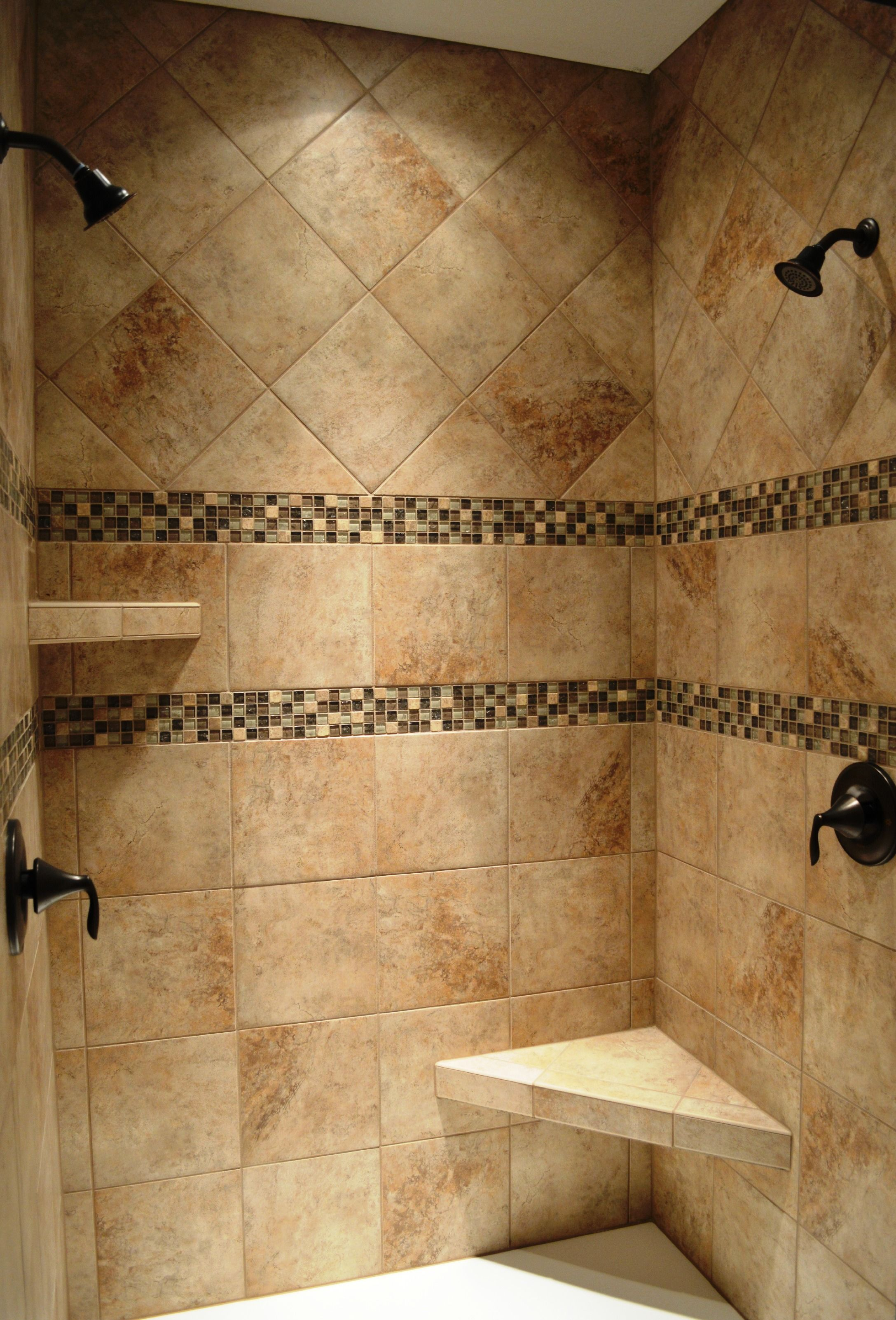Dual head custom ceramic tile shower with Oil Rubbed Bronze fixtures ...