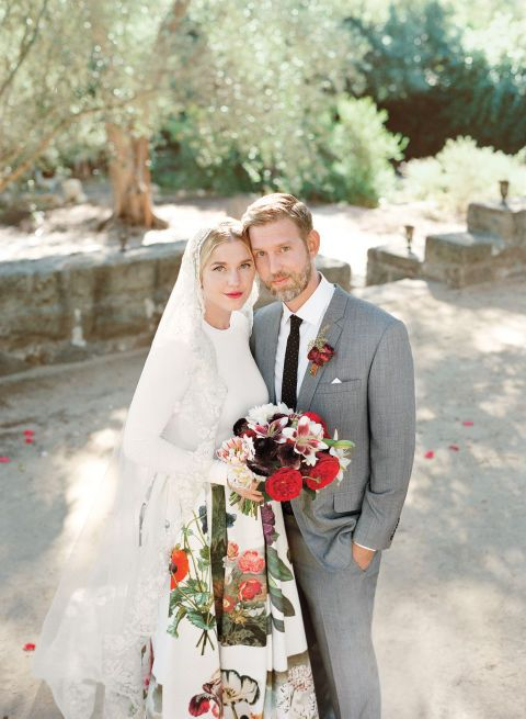 Petra, in a custom Stella McCartney top and skirt, showcased painterly flowers–from her printed skirt to an artfully-arranged bouquet. Marc donned a custom suit with an equally inspired boutonniere. Read more about this beautiful Santa Barbara wedding on BAZAAR.