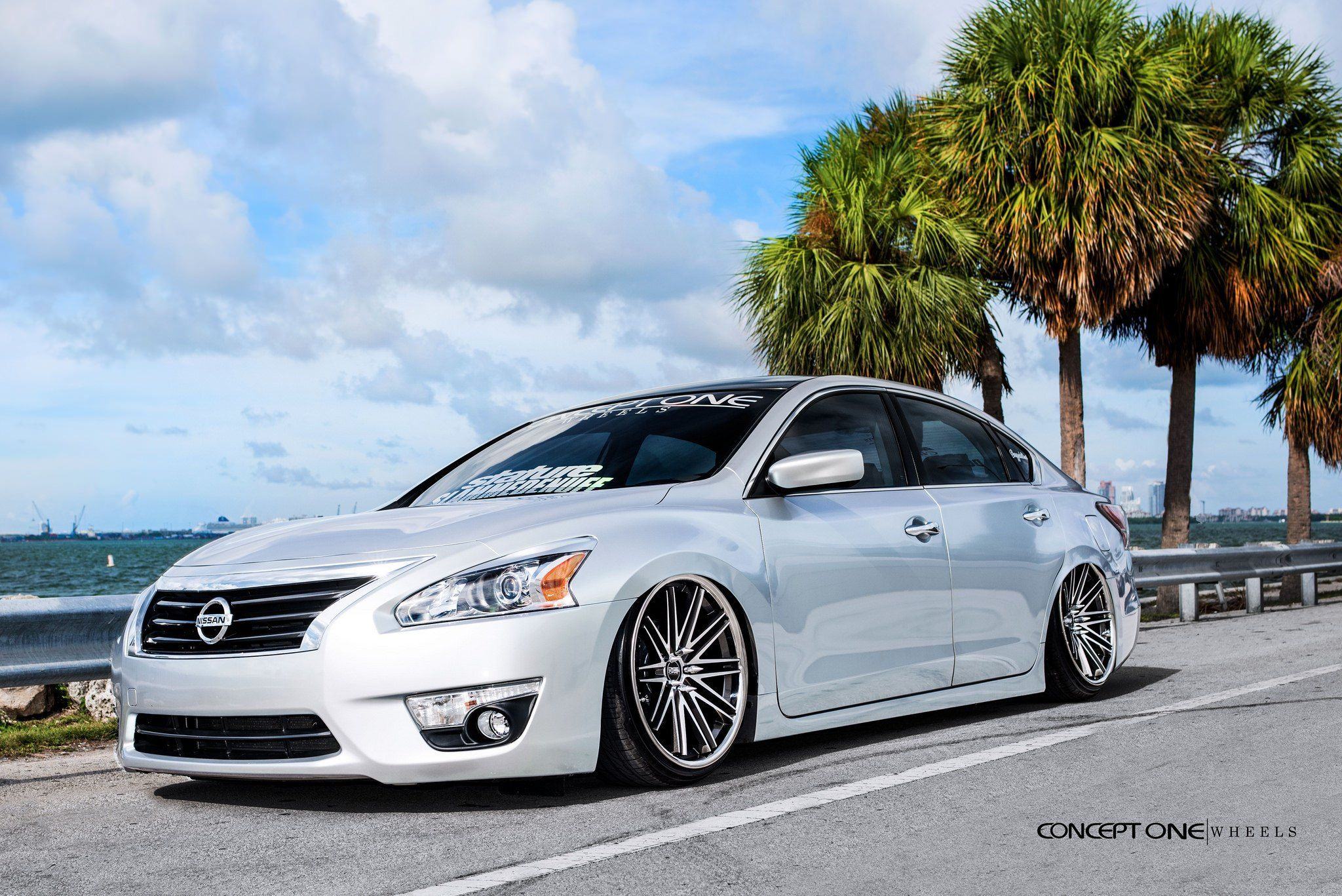 Jaw Dropping White Pearl Debadged Nissan Altima Customized to Amaze