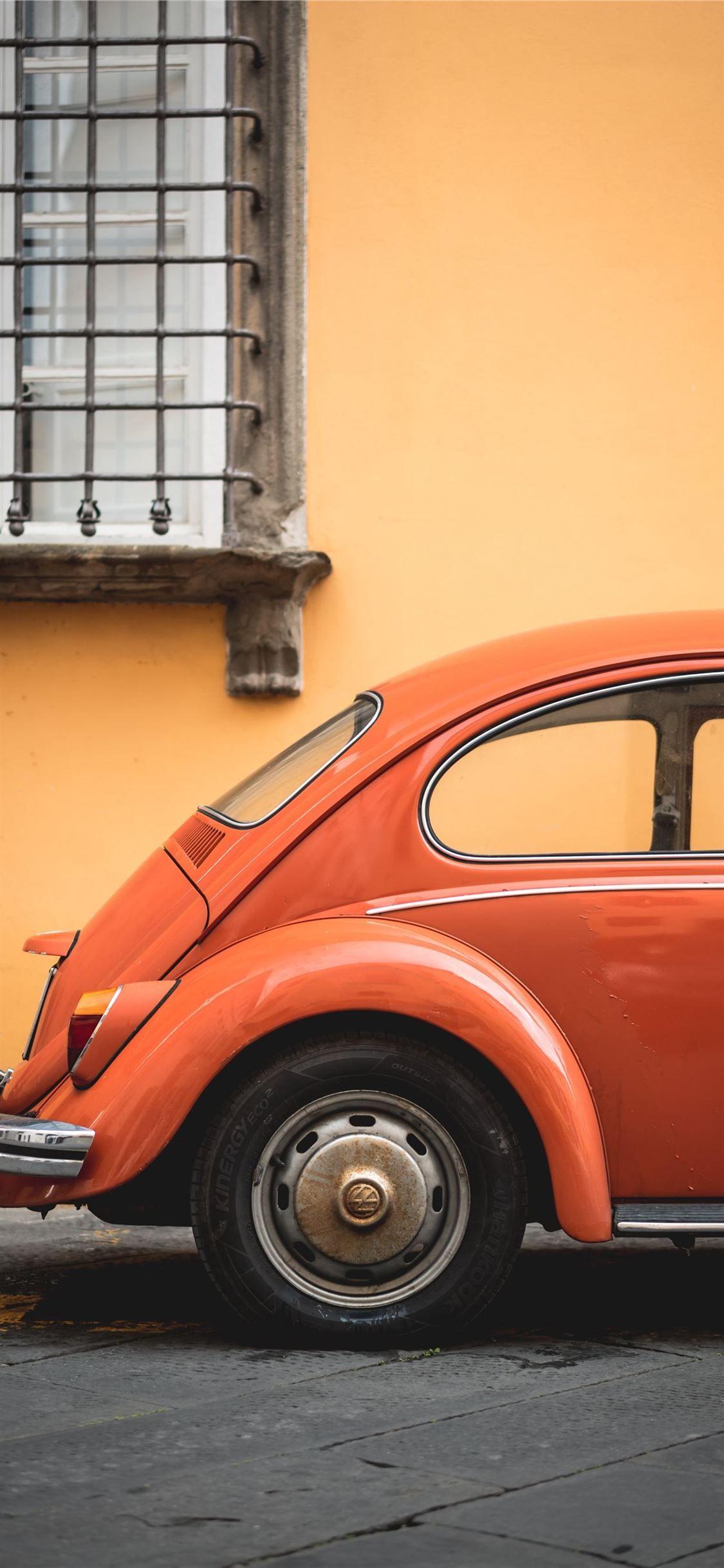 Shallow Focus Photo Of Orange Volkswagen Beetle Car Chrome Grey Iphonexwallpaper Volkswagen Beetle Beetle Volkswagen