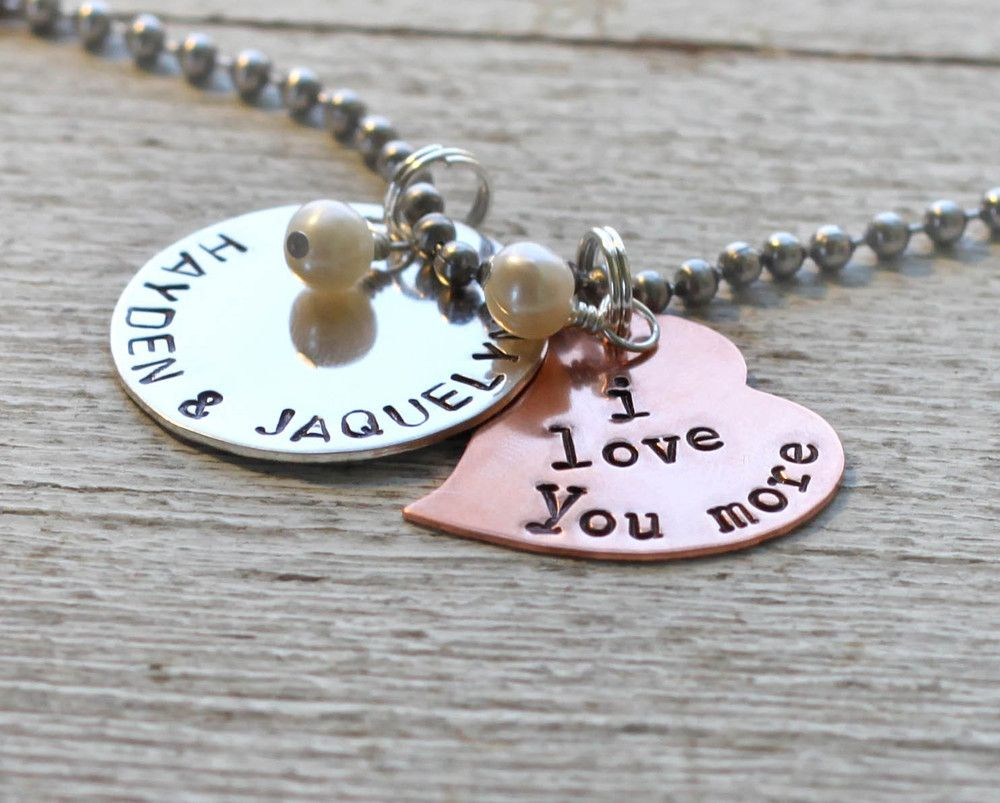 """""""I love you.""""  """"I love you more."""" One circle sterling silver disc is stamped with the 2 names of your choice.  And a copper heart is stamped with the words """"I Love You More.""""  the rusted chain"""