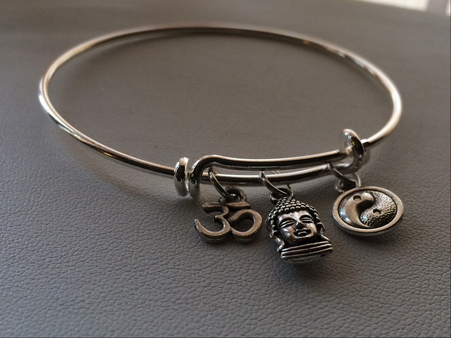 Ohm, Buddha & Ying Yang Charm Bangle - Ohm Bracelet, bali jewelry, yoga jewelry, reiki jewelry, buddha bracelet, namaste jewelry by AlyChrisBoutique on Etsy https://www.etsy.com/listing/218499810/ohm-buddha-ying-yang-charm-bangle-ohm