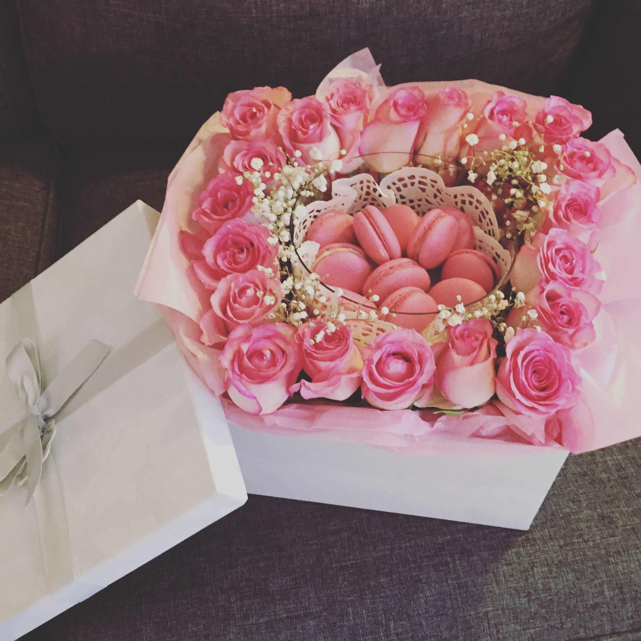 Flowers and macarons in a box with images flower box