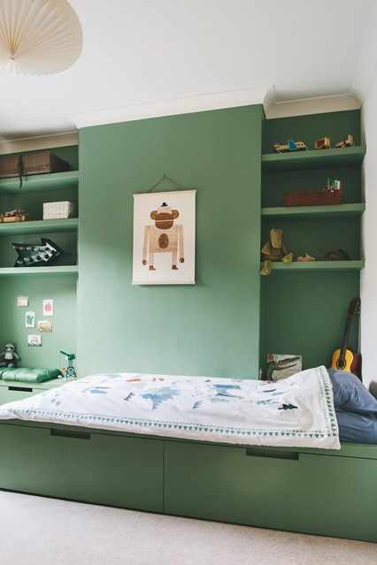 Green Kid's Bedroom With Underbed Storage in Children's Bedroom Ideas & Designs. Modern bedroom in Farrow & Ball's 'Breakfast Room Green' with shelving and drawer storage.