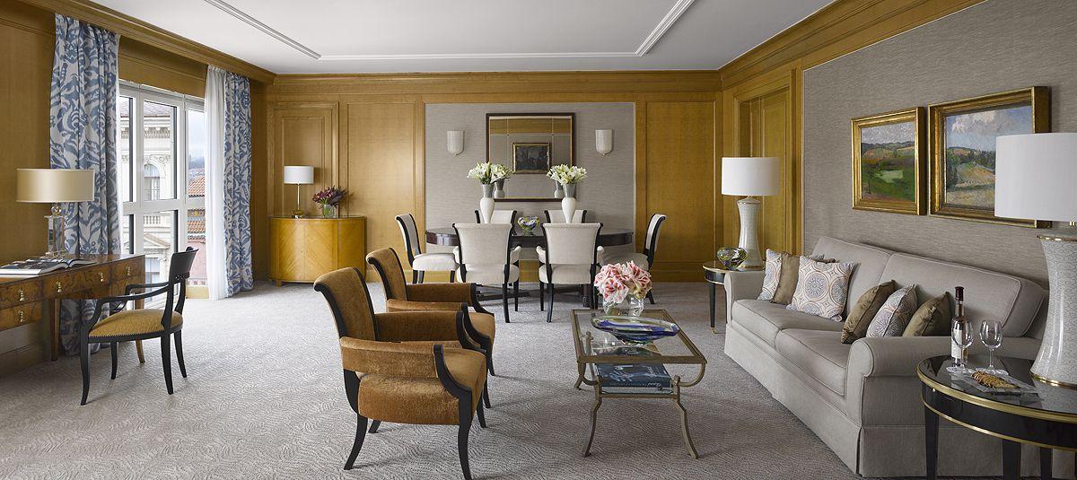 Premier Suite in Modern building at Four Seasons Hotel Prague. Spacious, elegant living room is offering beautiful views of the city.