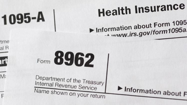 This Aug 21 2014 Photo Shows Health Care Tax Forms 8962 And1095