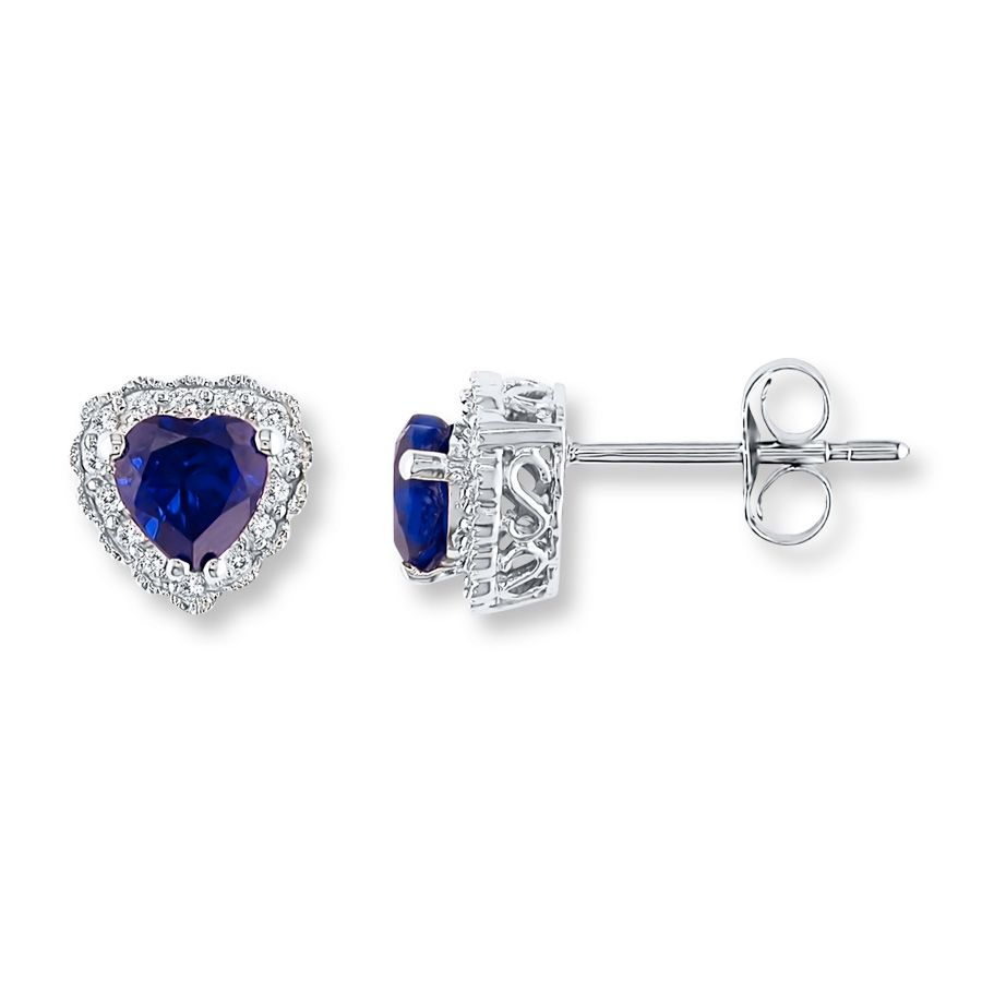 Heartshaped labcreated sapphires are encircled in brilliant round