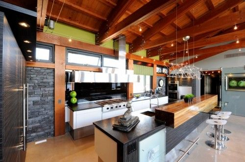 Awesome kitchen. Great mixture of materials for a warm, modern kitchen.