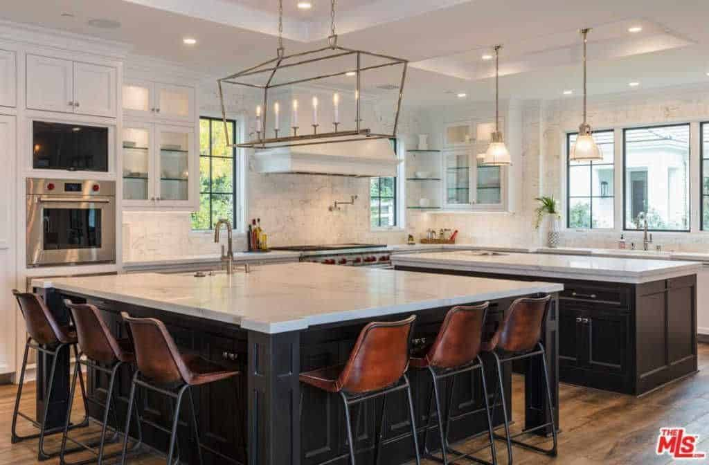 Large Kitchen Boasting Two Islands One Serves As The Meal Preparation Island And The Ot Large Kitchen Design Kitchen Island With Seating Kitchen Island Design