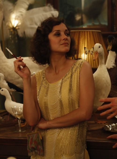 26ccff081f Midnight in Paris - Marion Cotillard as Adriana wearing a pale yellow beaded  flapper dress and tiny chain bag.