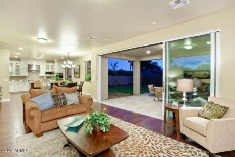 Open Floor Plan With Living Room Wall Opening To Outdoor Patio Area PHX