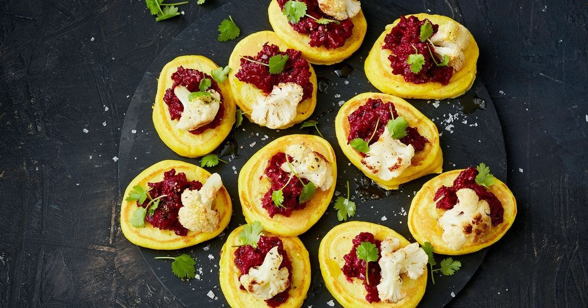 Turmeric blini with beetroot hummus and roasted cauliflower recipe turmeric blini with beetroot hummus and roasted cauliflower recipe vegetarian finger food finger food recipes and finger foods forumfinder Images