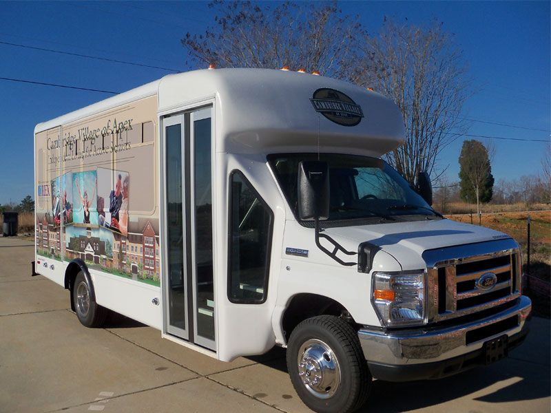 Cambridge Village of Apex partial bus wrap with perforated window graphics