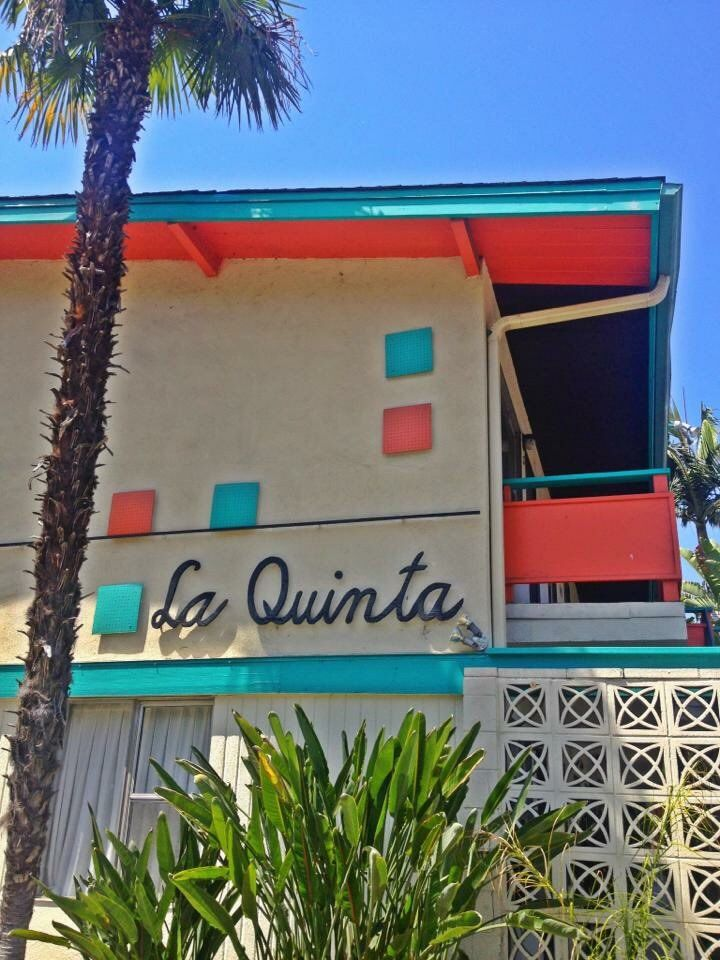 Catchy Apartment Name And Retro Font Plus Fun Pops Of Color Under Eaves Along Roofline
