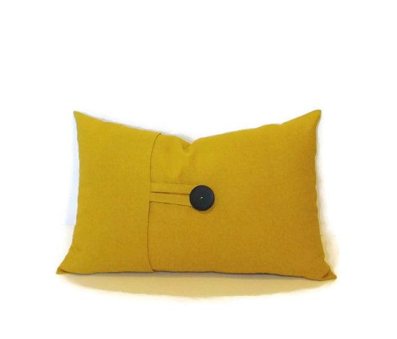 Decorative pillow cover in a golden mustard yellow linen blend home decor fabric.12x18 lumbar has front overlap with fabric loop and button closure.