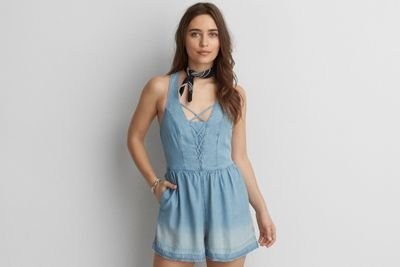 AEO Denim Lace-Up Romper by  American Eagle Outfitters | One and done. Effortless style in a must-have silhouette with serious attention to detail.  Shop the AEO Denim Lace-Up Romper and check out more at AE.com.