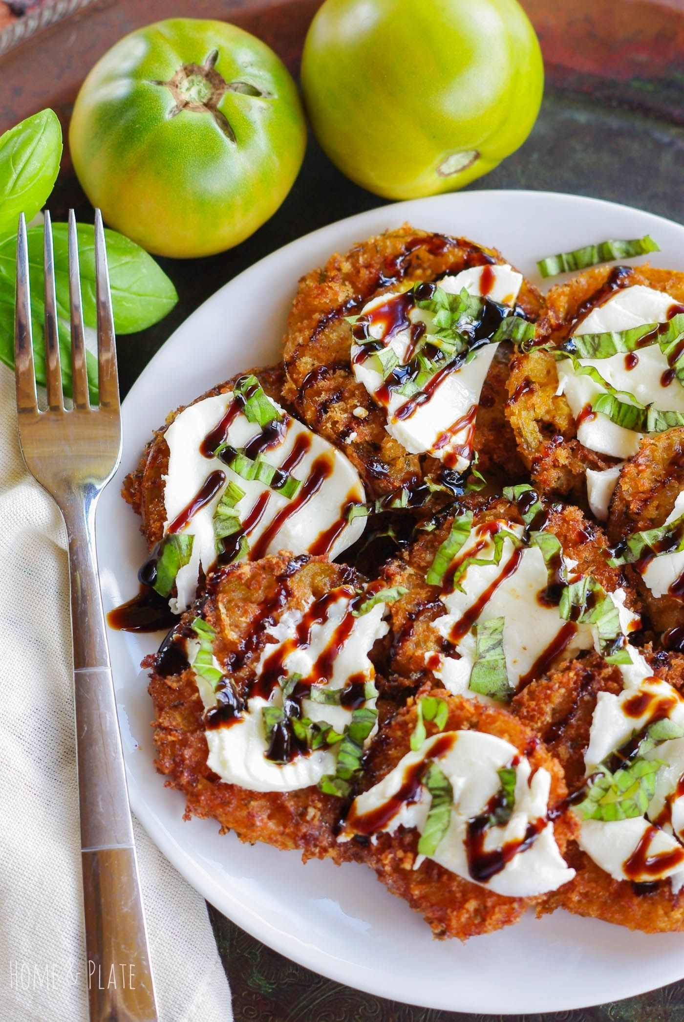 and Parmesan Crusted Fried Green Tomatoes Panko & Parmesan Crusted Fried Green Tomatoes |  | Don't throw away those unripe green tomatoes. Turn them into fried green tomatoes topped with fresh mozzarella cheese and chopped basil and finished with a balsamic glaze.Panko & Parmesan Crusted Fried Green Tomatoes |  | Don't throw away those unripe g...