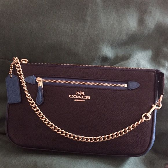 """Coach NWT Color-Block Nolita Chain Wristlet 24 Absolutely GORGEOUS BNWT 100% Guaranteed Authentic 3-in-1 Wristlet/Shoulder/Clutch Bag from Coach.  A stunningly versatile MUST-HAVE bag for the upcoming Spring/Summer season, crafted in finely pebbled leather boasting shades of Peacock and Navy Blue. This bag can hold a tablet and other essentials and can be carried as a wristlet OR worn on the shoulder OR tucked into a larger bag. Zip-top closure, fabric lining, outside zipper pocket. 9 1⁄4""""…"""