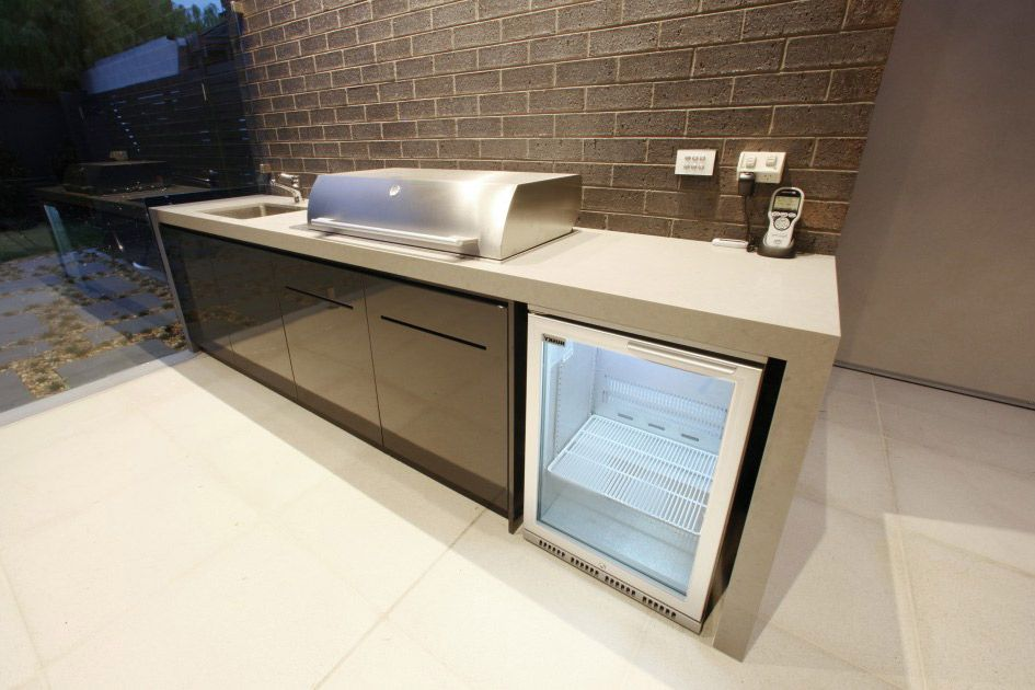 outdoor kitchen with counter wrapping around modular cabinets to ...