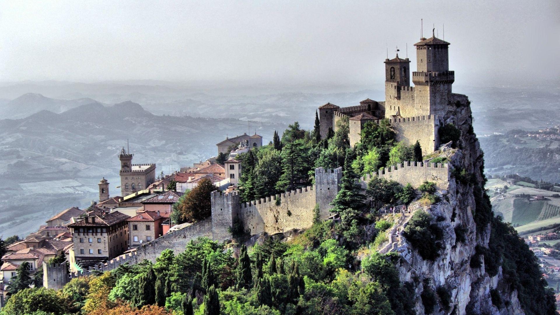 1920x1080 Wallpaper city, country, san marino, landscape, castle, cliff, houses, buildings, mountains, sky
