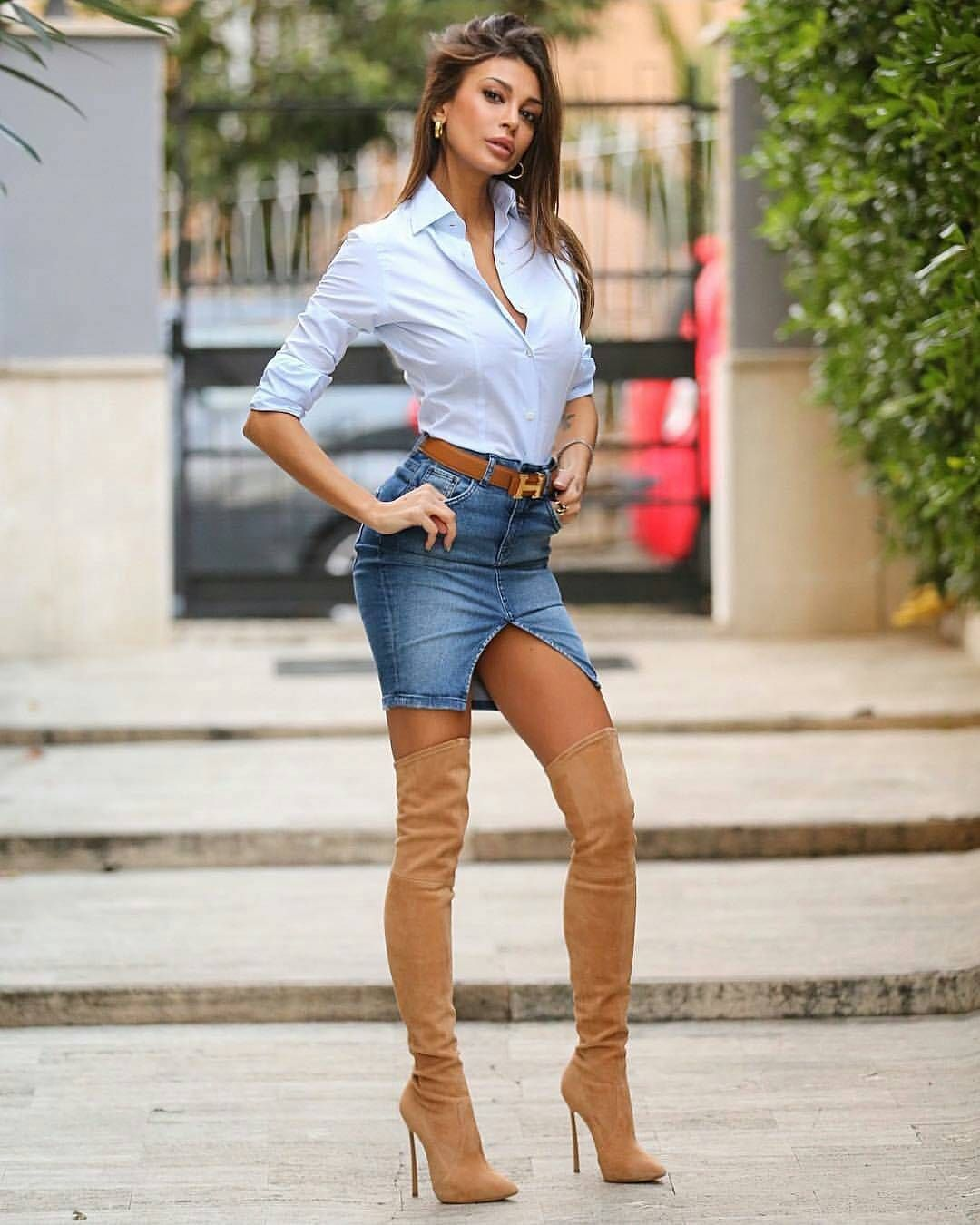 brown high heel thigh high boots combined with short skirt ... 2c7edc837