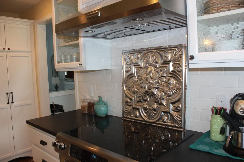 Fabulous backsplash behind stove. Tin ceiling tile from http://www ...