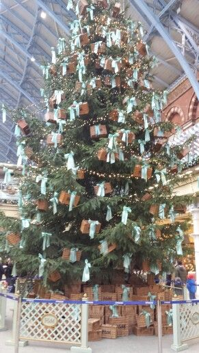 Fortnum and mason christmas tree 2013 St Pancras Station London. Decorated with fortnum and manson hampers and teal bows.