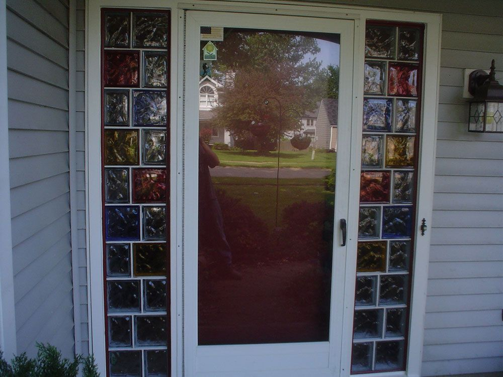 Decorative colored glass blocks create a welcoming for Where to buy glass block windows