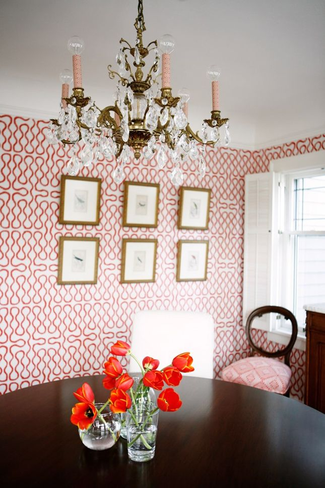Graphic wallpaper juxtaposed with traditional furnishings and chandelier