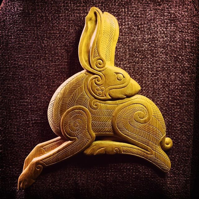 The completed Irish Hare carving in butternut. I have just finished carving at this point and still need to add the oil and wax finish - but I thought it would be interesting to  show before and after shots. Plus I am so excited to have it done I couldn't wait! #ninthwavedesigns #irishhare #hare #woodcarving #carving #handcarved #celtic #celticart #celticcarving #spiral #spirals #butternut #finishedproject