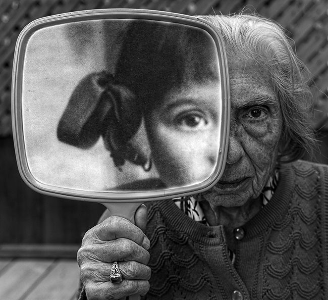 """Tony Luciani's """"Internal Reflection."""" Dementia tears you in half. Both are her and of her, many years apart, but together in her mind.    