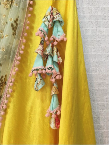 67f6f77c33 Yellow Off-Shoulder Lehenga Twisted Threads. Gorgeous pom pom floral  latkans. #Frugal2Fab