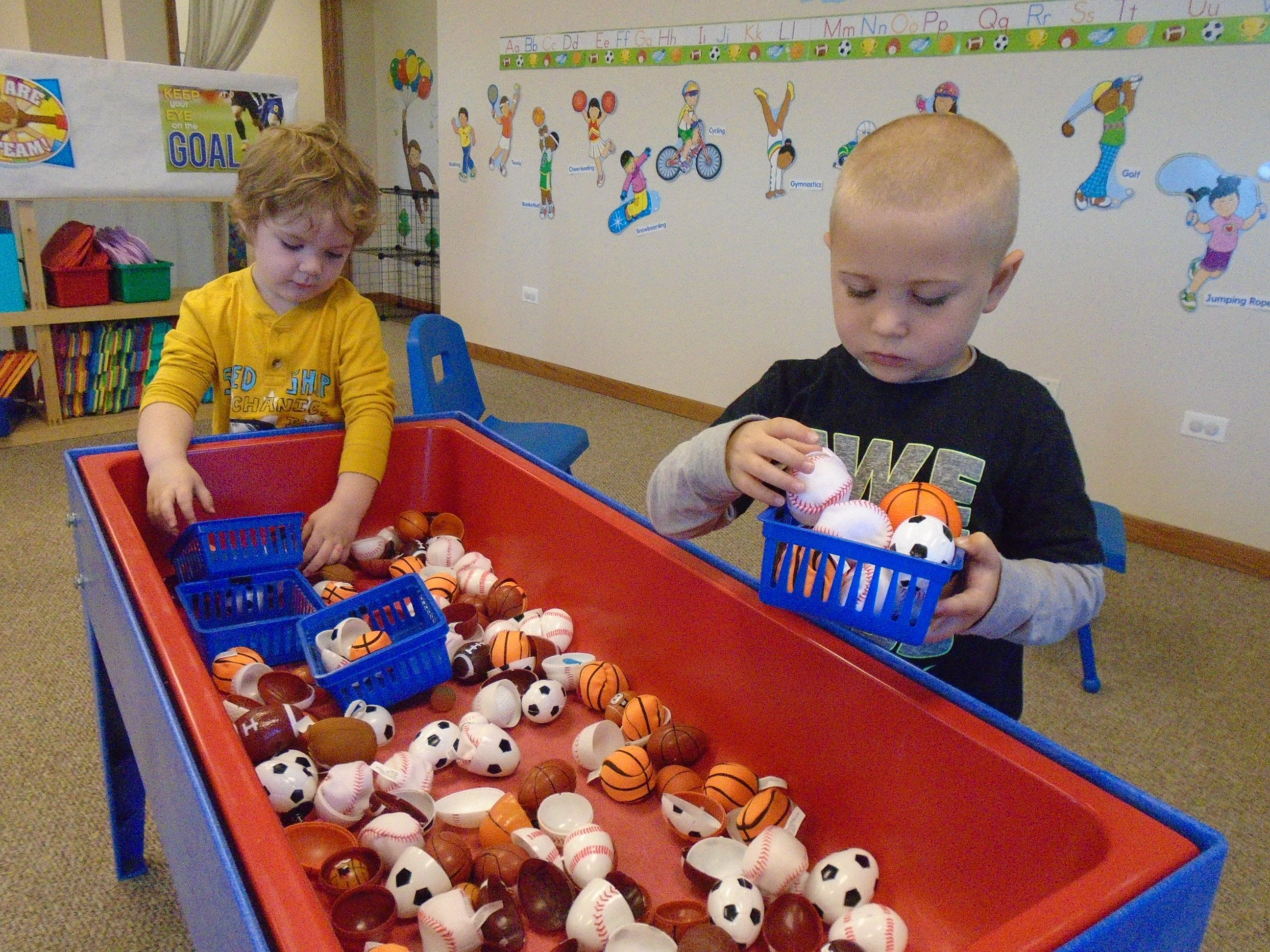 Sensory Table With Small Balls And Sport Eggs With Baskets