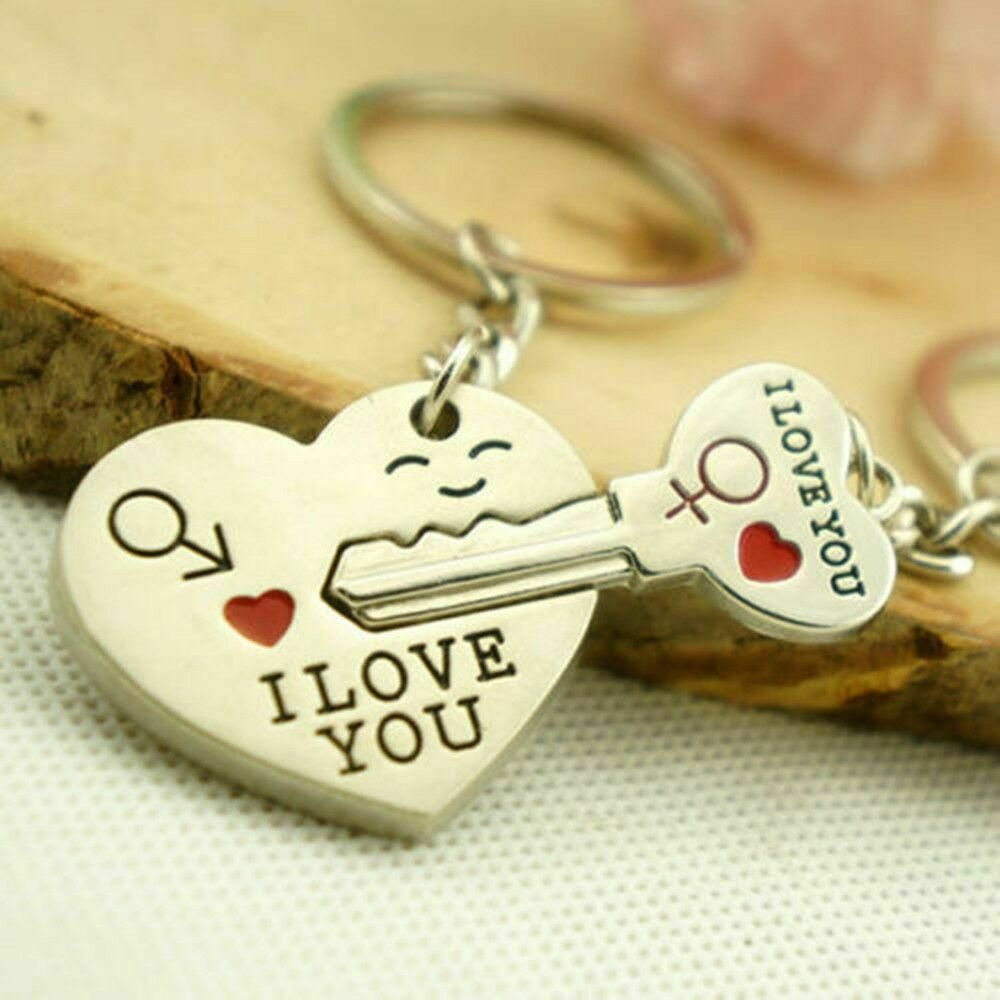 "Couples ""I Love You"" Heart and Key Keychain Set 2-Piece Set Comes with One Heart Keychain, One Key Keychain Key Fits Together inside Heart Each item has red heart design and inscription of ""I Love You"""