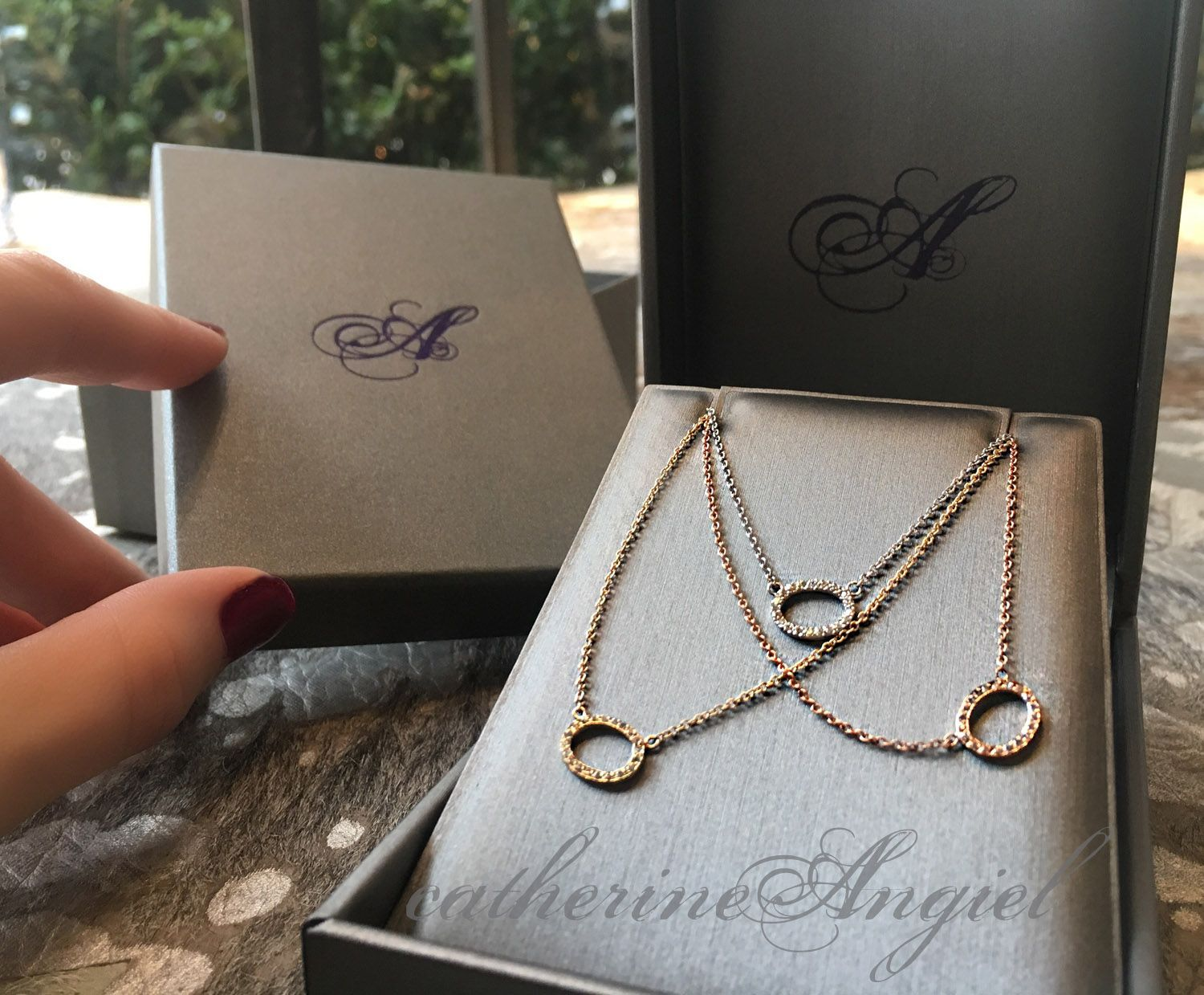 Yellow white or rose gold necklace with an open oval diamond