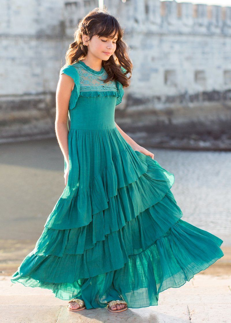 5c5ae7336ced7 Timeless and elegant, this maxi dress features flounced, cap sleeves, a  high lace