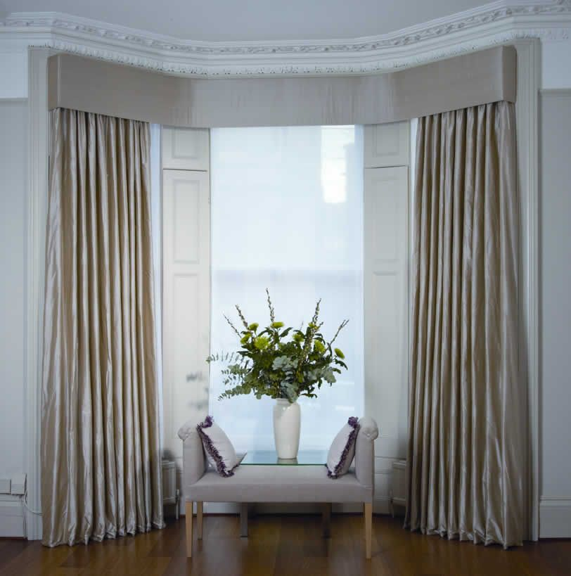 Swags tails in a bay window with interlined curtains in for Window design in nepal
