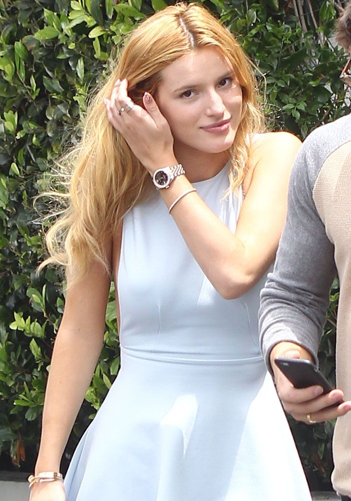 856480d9f50 Bella Thorne Goes on a Braless Date in Stuart Weitzman Sandals ...
