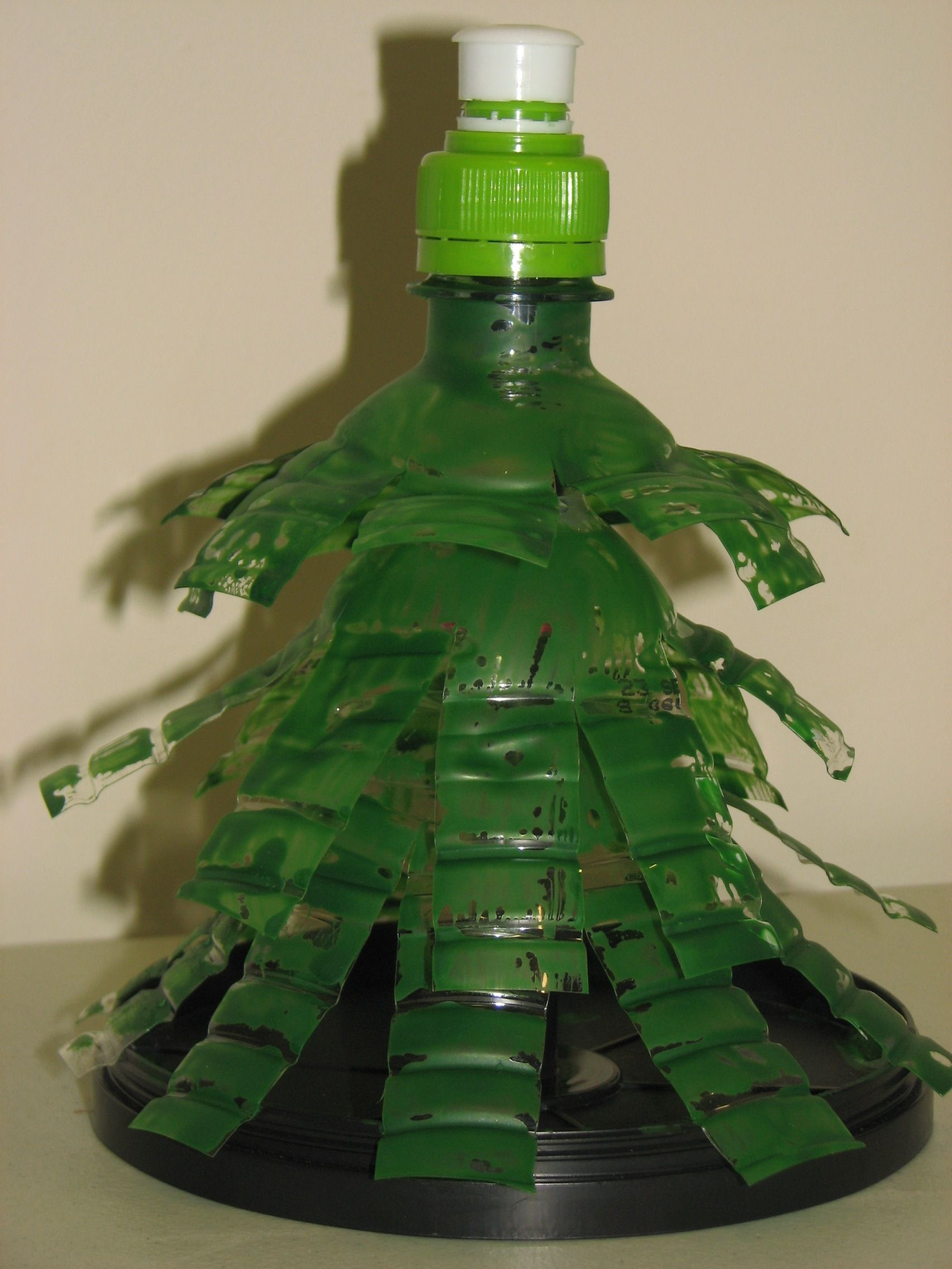 Painted water bottle make a great recycled christmas tree for Christmas decorations from recycled plastic bottles