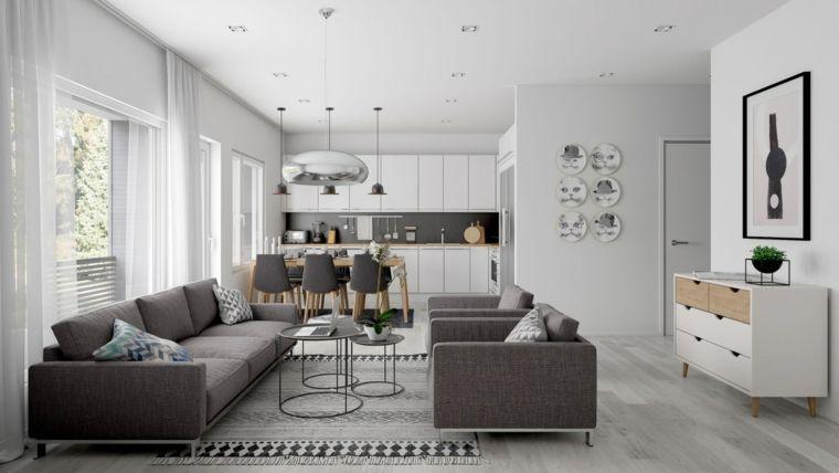Luminoso arredamento per soggiorni moderni con divani grigi zona